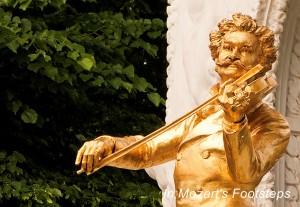 "The golden statue of the ""Waltz King,"" Johann Strauss, Jr. in Vienna's Stadtpark."