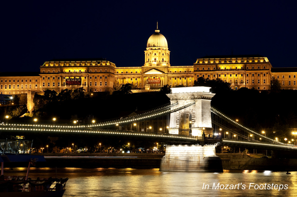 Budapest's Chain Bridge crosses the Danube River in front of the Palace.